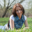 Stockfoto: Woman in green grass