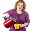 Woman with kettle and cup — Stock Photo