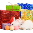 Stock Photo: Two white rabbits with gifts