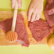 Cook hands making meat tenderizer — Stock Photo