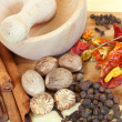 Various natural spices with pestle and mortar — Stock Photo