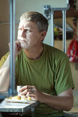 Man looking to window in sleeper train — Stock Photo