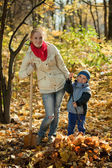Woman with her son working in autumn — Stock Photo