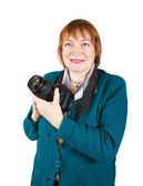 Senior female photographer with camera — Stock Photo