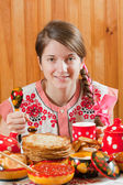 Girl eating pancake with caviare — Stock Photo