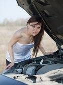 Woman with breakage car — Stock Photo