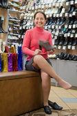 Woman shopping at shoes shop — Stock Photo