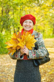 Laughing mature in autumn park — Stock Photo