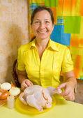 Woman sewed stuffed chicken — Stock Photo