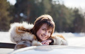 Happy woman near her car — Stock Photo