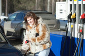 Woman filling her car — Stock Photo