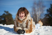 Girl lying on snow — Stock fotografie