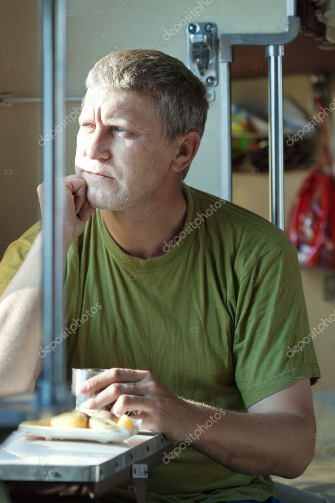 Middle-aged man looking to window in sleeper train  Stock Photo #8140102