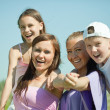 Two happy women with teens — Stock Photo