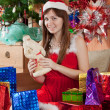 Gir with christmas presents — Stock Photo