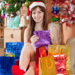 Girl with christmas gifts — Stock Photo #8998909