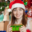 Portrait of gir with christmas presents — Stock Photo