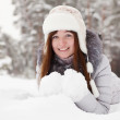 Girl lying down on  snow — Stok fotoğraf