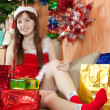 Girl  with christmas gifts — Stockfoto