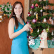 Woman near Christmas tre — 图库照片