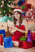 Gir with christmas presents — Stock Photo