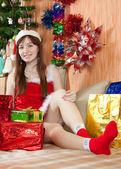 Girl with christmas gifts — Stock Photo