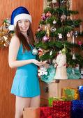 Girl near decoration spruce — Stock Photo