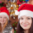 Girls in Christmas hats — Stock Photo #9000464