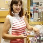 Woman chooses nail varnish — Stock Photo