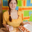 Woman with bacon and eggs - Stock Photo