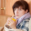 Stock Photo: Illness womdrinking tea