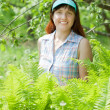 Woman in fern plant — Stock Photo