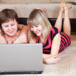 Happy  women using laptop in home — Stock Photo