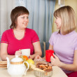 Girls drinking tea and gossiping — Stock Photo #9002316