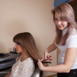 Stock Photo: Hair stylist working with girl