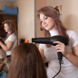 Hairdresser working with hair dryer - Stock Photo