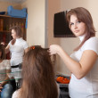 Hairdresser working with  girl - Stockfoto