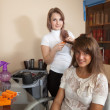 Hair stylist working with long-haired girl - Stock Photo