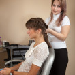Female hair stylist working with girl - Stockfoto