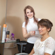 Hairdresser working with long-haired girl — Stock Photo