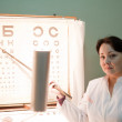 Ophthalmologist with letter table — Stock Photo #9003963