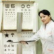 Ophthalmologist testing  eyesight - Stock Photo