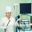 Doctor with endoscope ready for work - Stock Photo