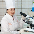 Stock Photo: Doctor with microscope in lab