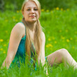Girl relaxing outdoor in grass — Stock Photo #9004244