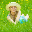 Girl in hat on meadow — Stock Photo #9004251