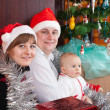 Family near Christmas tree — Stock Photo