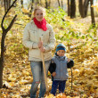 Woman with son gardening in autumn — Stock Photo #9006914