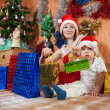 Mother and little son with Christmas gifts — Foto de Stock