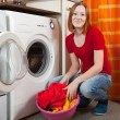 Young woman doing laundry — Stock Photo #9006985